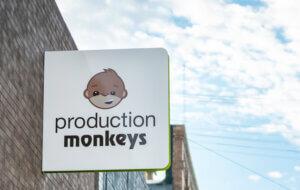 Production Monkeys logo on exterior signage